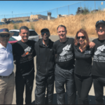 Frank Ruona, Kevin Rumon, Eddie Hart, Mark Stevens, Science In Sport's Tonya Wearner and Jim Maloney outside San Quentin State Prison