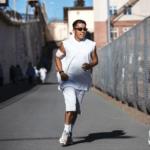 Jonathan Chiu running behind Eddie Herena