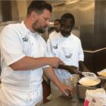 Chef Huw Thornton helping Les Hamilton prepare Chantilly crepes
