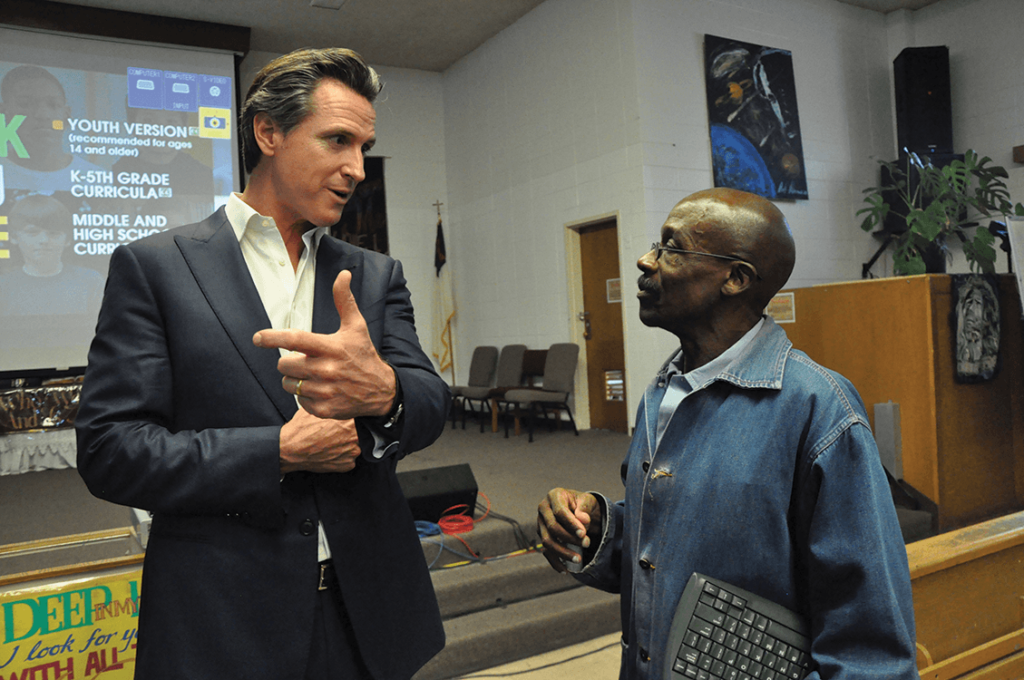 Lt. Governor Gavin Newsom talking with Juan Haines