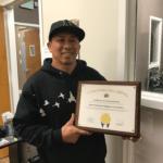 Nighiep Ke Lam proudly holding up an APSC award