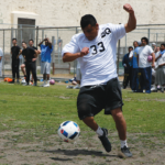 Carlos Ramirez playing soccer on the Lower Yard