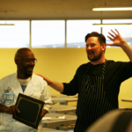 Graduate Derry Brown receiving certificate from Chef Huw Thorton