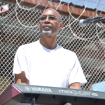 Kevin D. Sawyer on background vocals and playing keyboard