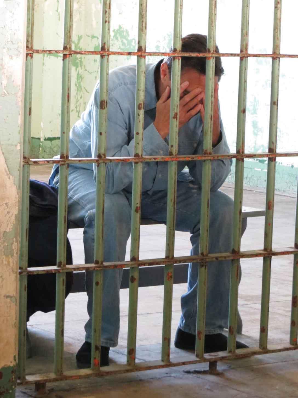 An inmate cries behind bars