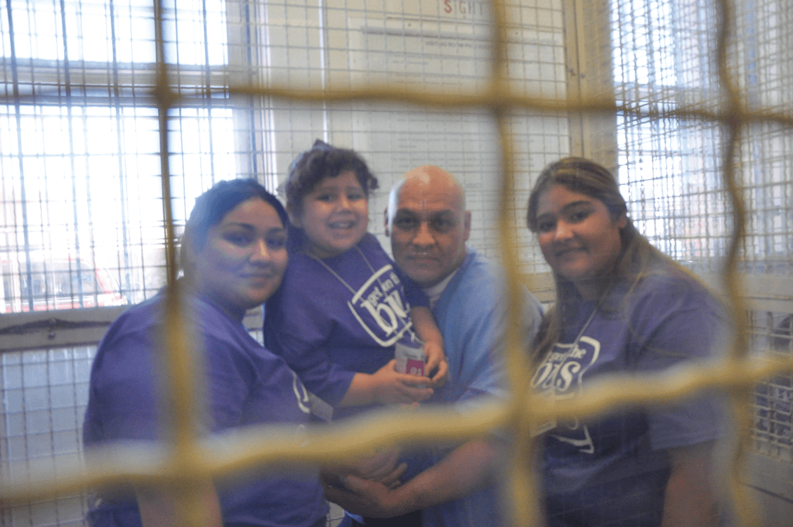 Inmate Christopher Jasso and Family at Get On The Bus, San Quentin State Prison, July 2017.