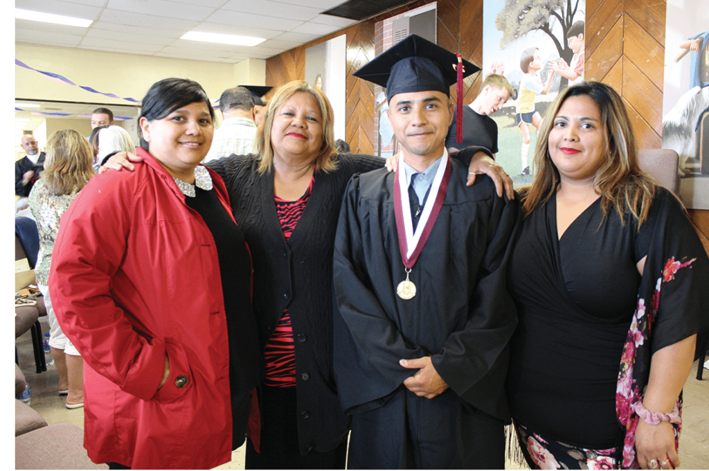 Sister Sophia, mom Sandra, graduate Eddie Herena, and sister Monica