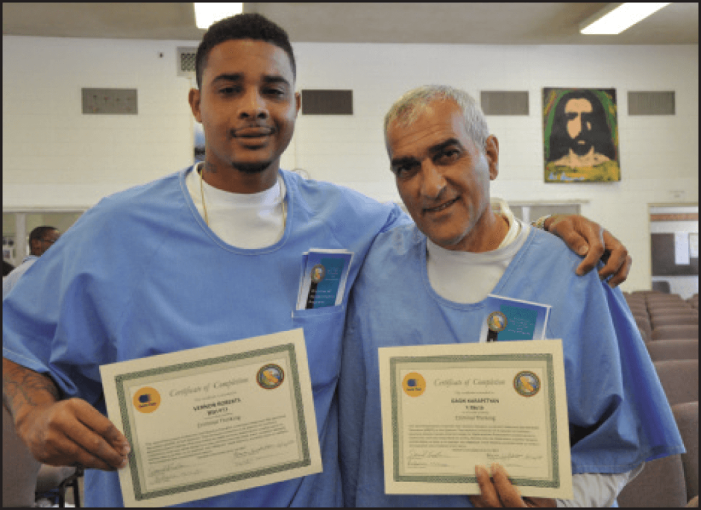 Vernon Roberts and Gagik Karapetyan proudly displays their certificates of completion