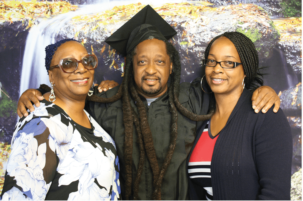 Aunt Peggy Stovall celebrates with graduate Shawn Garth and cousin Lakeisha Scott