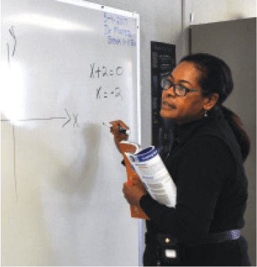 Dr.-L.-Marez-demonstrating--how-to-solve-a-math-problem