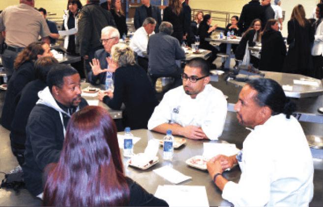 Eddie-Landeros-(center)-and-Julio-Saca-(left)-speaking-with-potential-employers