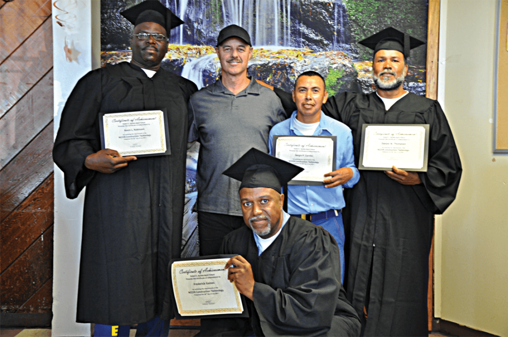 Vocational instructor Dante Callegari with his graduates Kevin Robinson, Sergio Carrillo, Donald Thompson and Fredrick Gaines