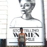 "Tatyana Fazlalizadeh campaigning against street harassment of women with her poster ""Stop Telling Women to Smile"""