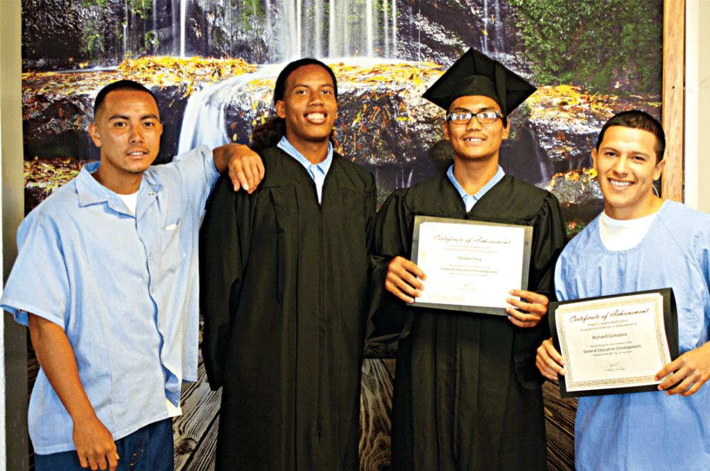 Vocational graduates Chris Nguyen, Rayven Jenkins with GED graduates Charlie Srey and Richard Gonzalez