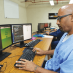 Inmate learning to code at Code7370