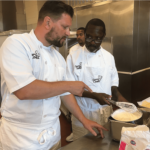 Chef Huw Thornton helping Les Hamilton prepare Chantilly crepes