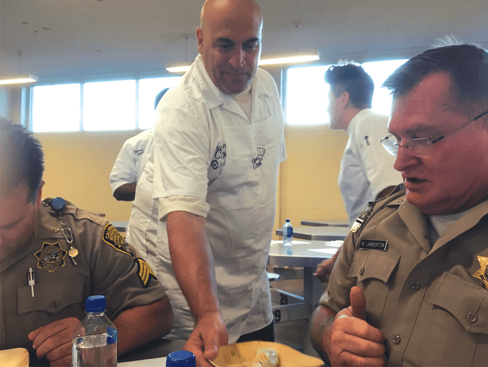 Steve Piazza serving meals to correctional officers