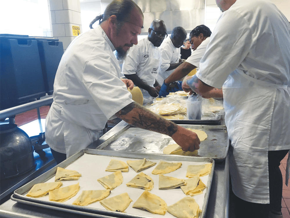 Inmates preparing raspberry Nutella crepes