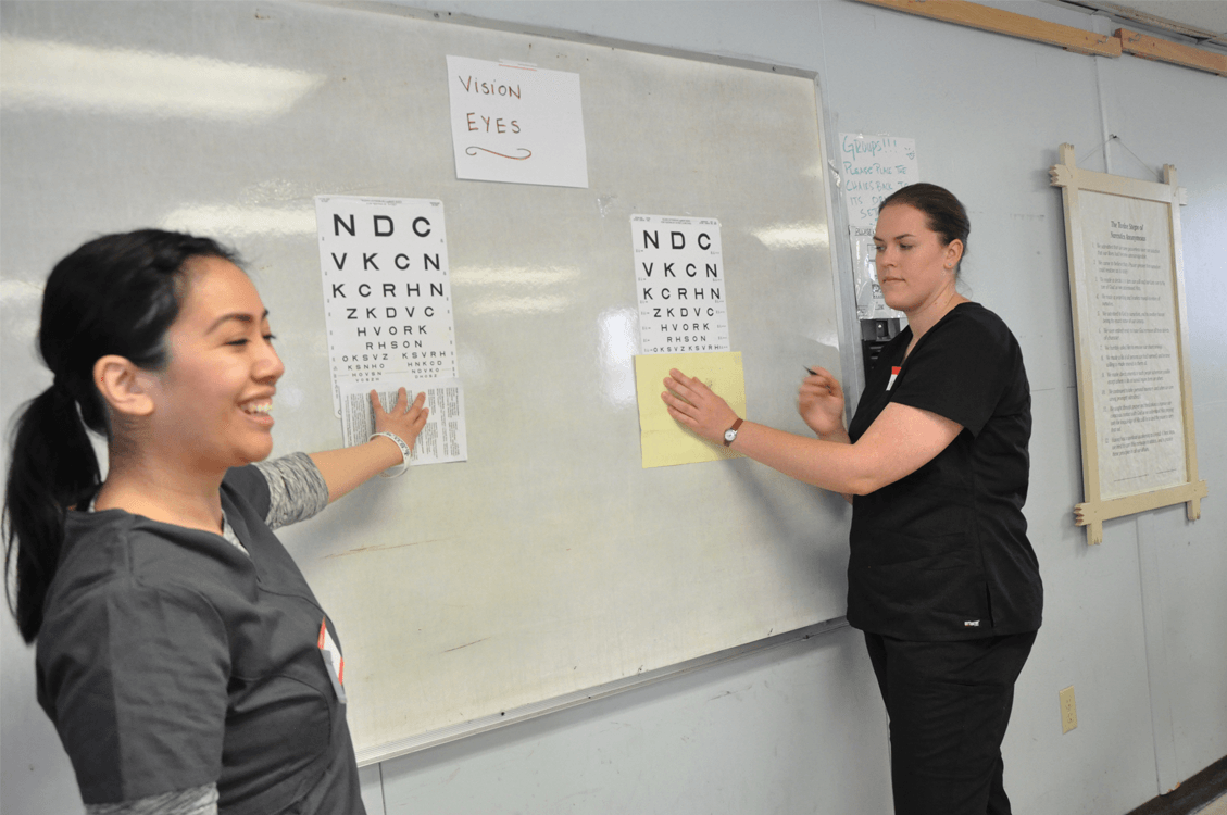Nurses demonstrating eye exams