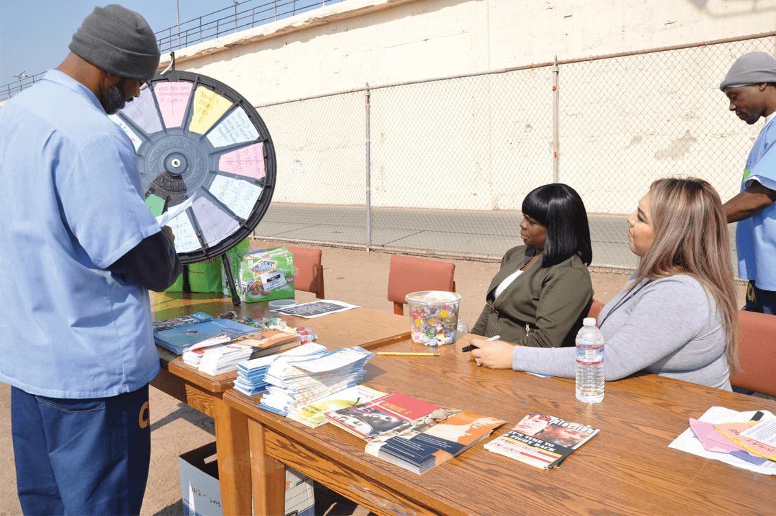 Participants spinning the wheel about the facts of STDs