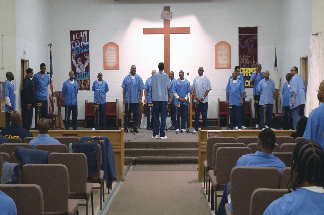 "Choir preparing to sing ""Bless Your Holy Name"""