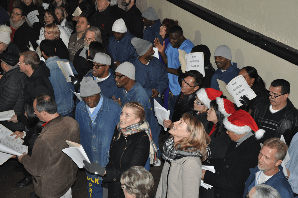 Inmates and volunteers singing in West Block