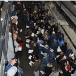 West Block inmates enjoying caroling from the Protestant choir