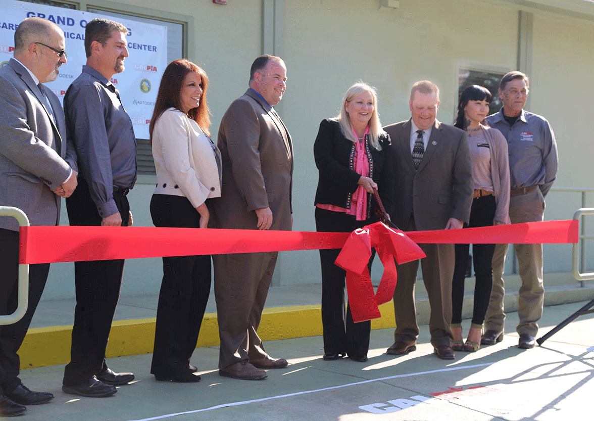 Kathleen Allison, director of the Division of Adult Institutions, cuts the ribbon at one of the facilities