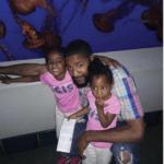 Johnson and his daughters, Naomi and Sheyane, at the Monterey aquarium