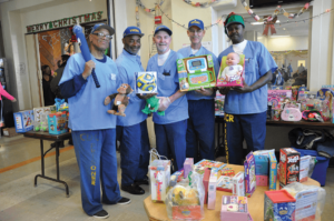 Veterans displaying the various toys for the children
