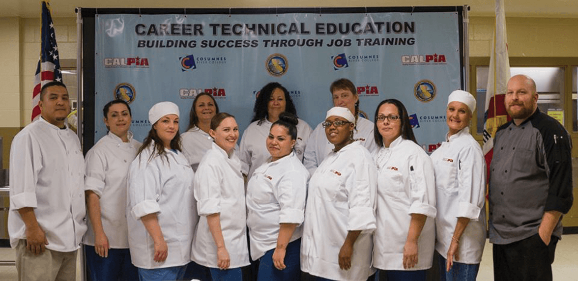 The women of the first Culinary Arts Management program with their instructor