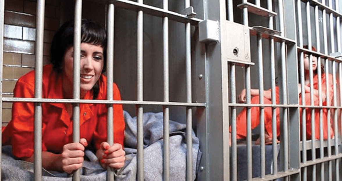 Women locked up behind bars in a United States jail