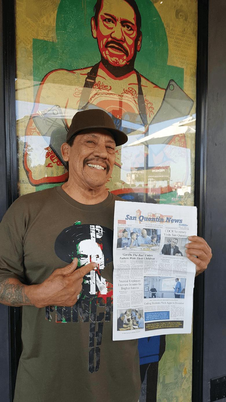 Danny Trejo holding SQ News