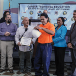 N.A. Chaderjian youth graduate Luis Alvardo receiving his certificate