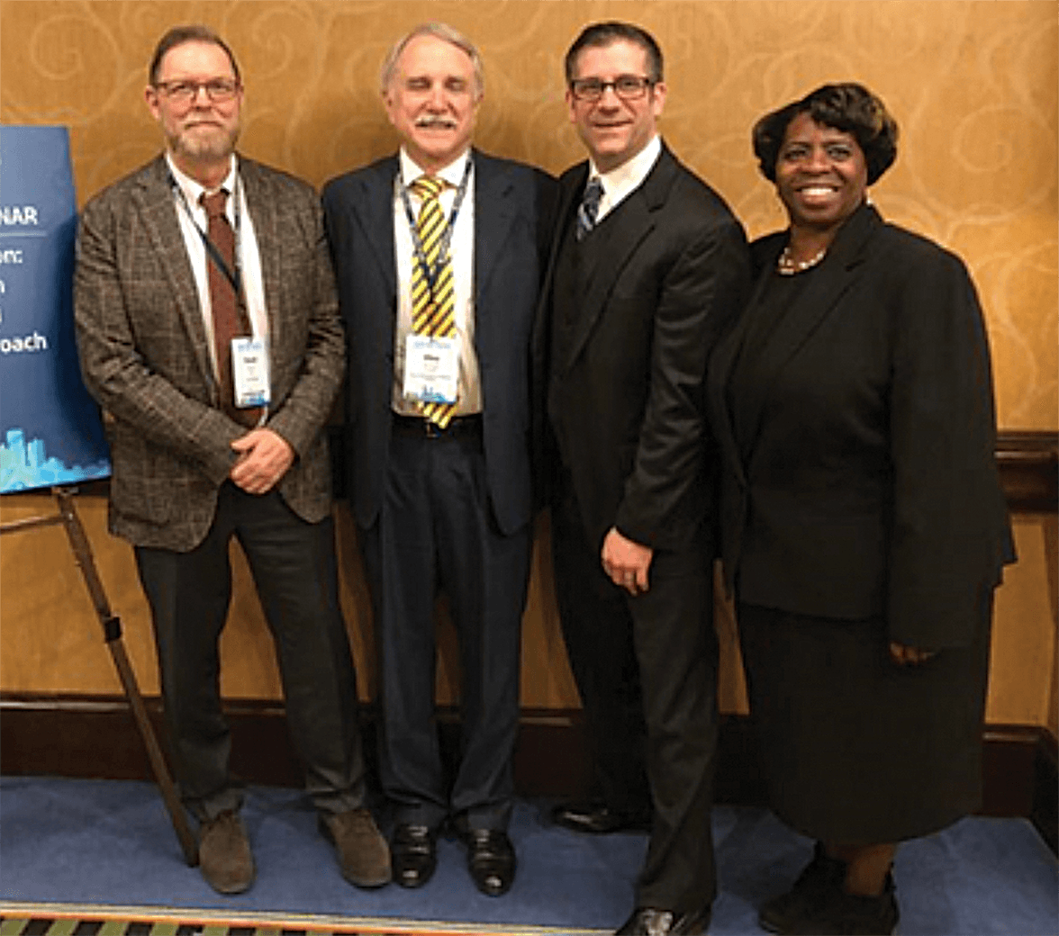 Nyack College's Dr. David Turk, Dr. Michael Scales, and Cynthia Dorsey with Sean Pica in Dallas