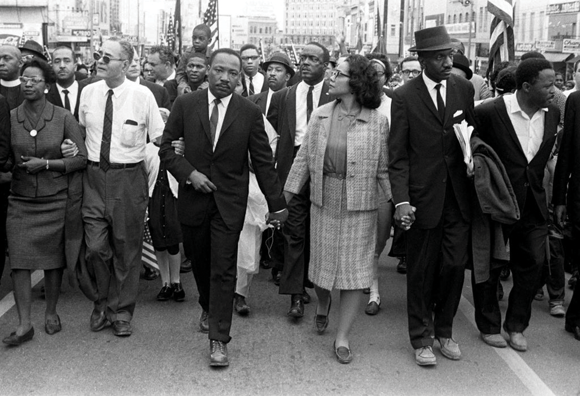 Martin Luther King, Jr walking with marchers