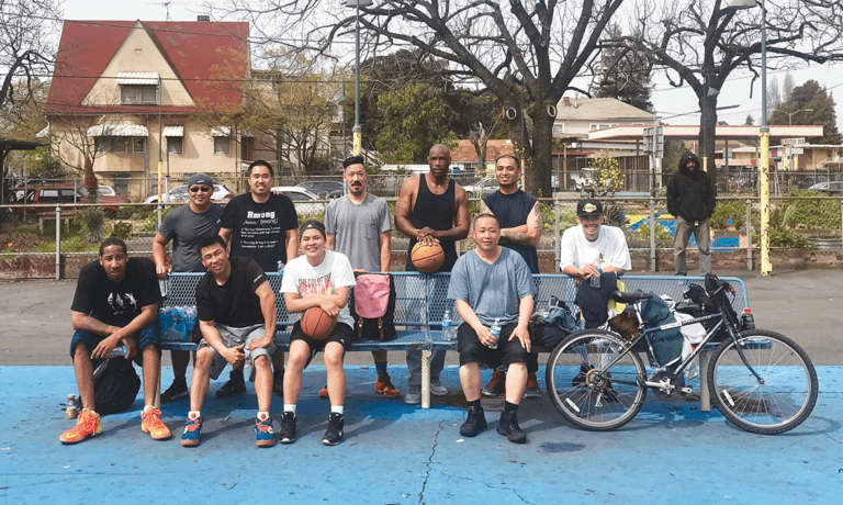 ROOTS' basketball event with Top: Danny Thongsy, Nate Tan, Roger Chung, Troy Smith, Asian Health Services member and Chau Vi. Bottom: Donte Smith, Nighiep Ke Lam, Tracy Nguyen and Zitsue Lee