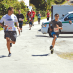 Chris Schuhmacher passing another runner at the Mt. Tamalpais in the Dipsea Race