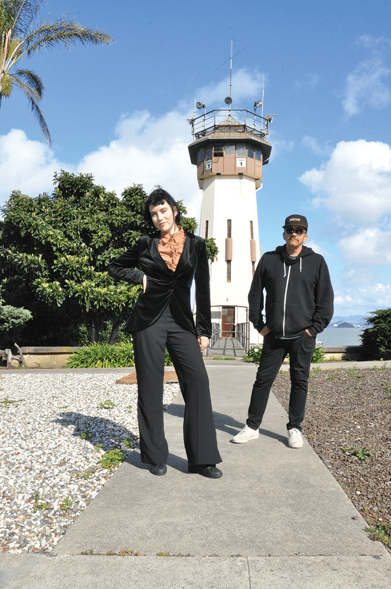 Queeny King and DJ Kraig in front of San Quentin