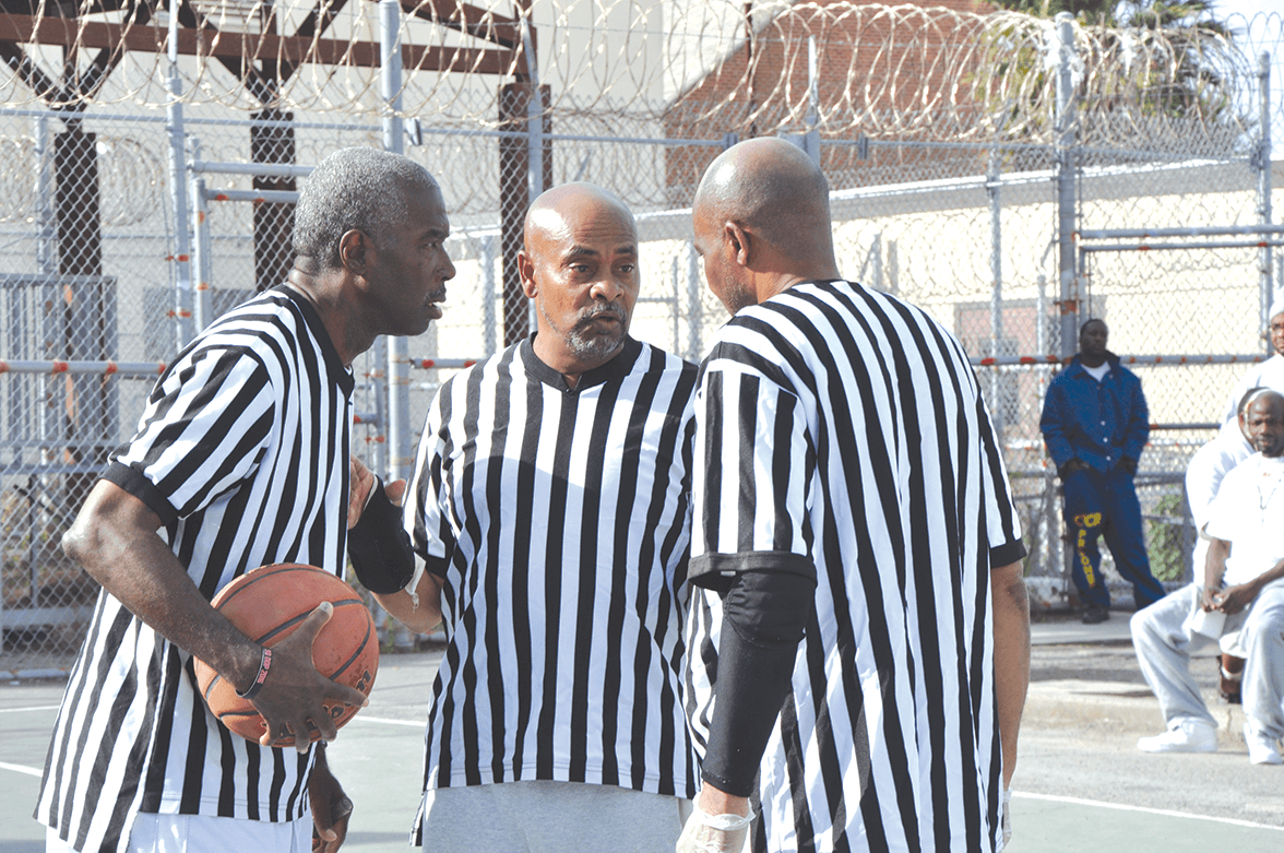 "Veteran ref Robert Lee in 2017 advising the old referee crew Willie ""Butch"" Thompson and Ishmael Freelon"