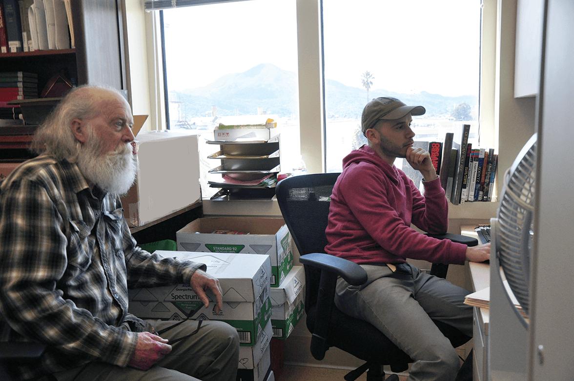 Senior librarian Douglas Jeffrey and Gabriel Loiederman