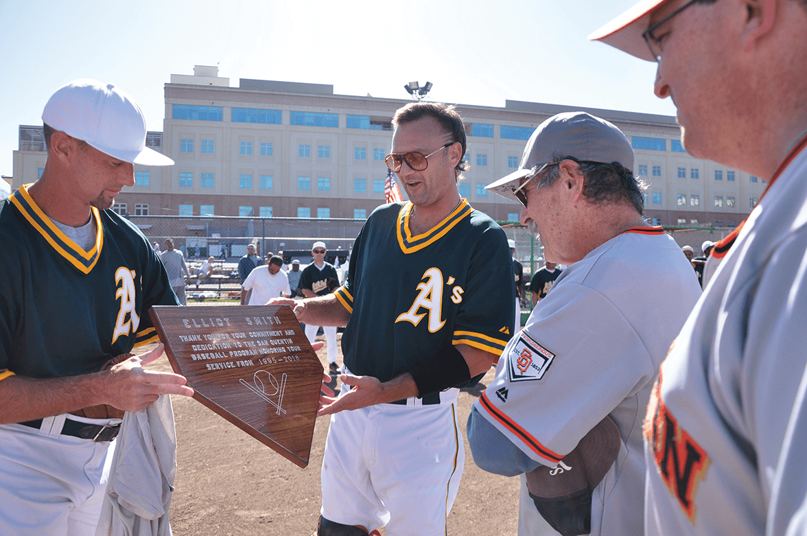 Trevor Bird presents Smith with his plaque