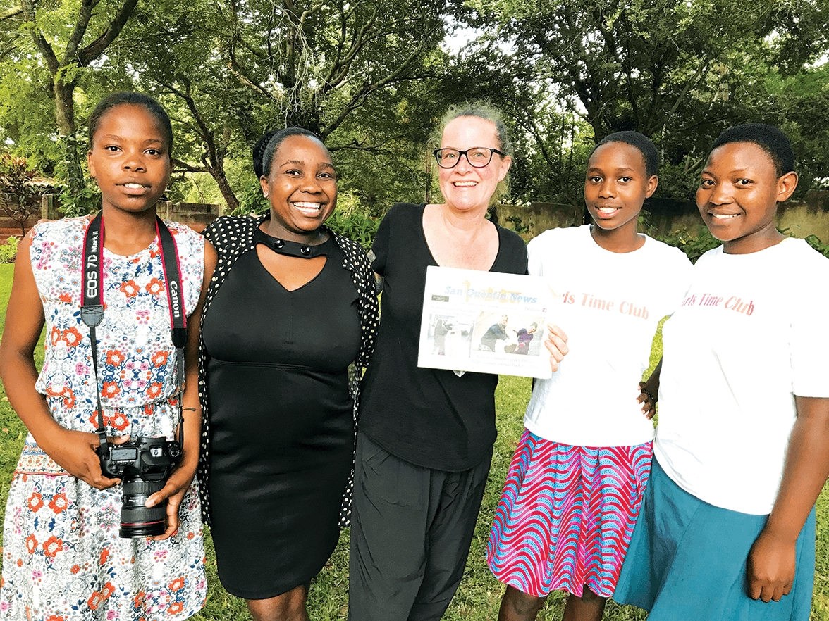 Erin West and members of the Global Sojourns Giving Circle in Victoria Falls, Zimbabwe. The Giving Circle benefited from several food drives at San Quentin hosted by CGA