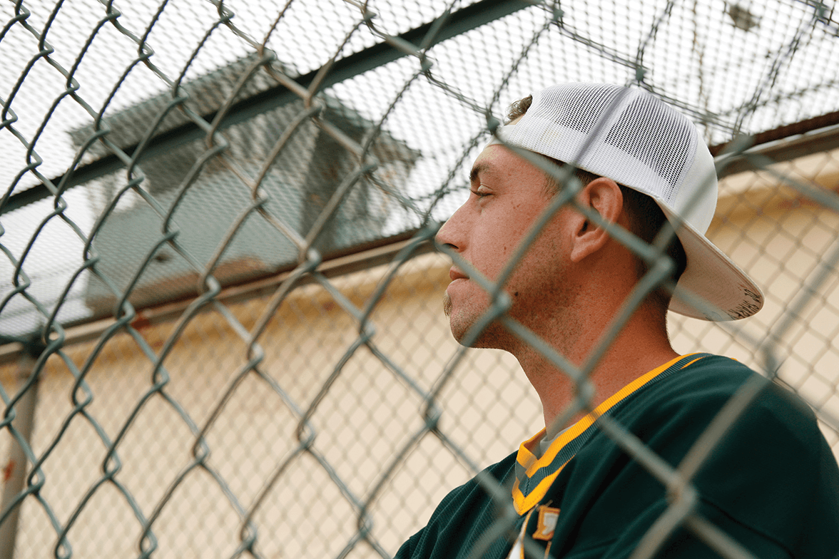 A's Brian Holliday overlooking the game
