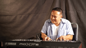 AJ Gonzales on the piano