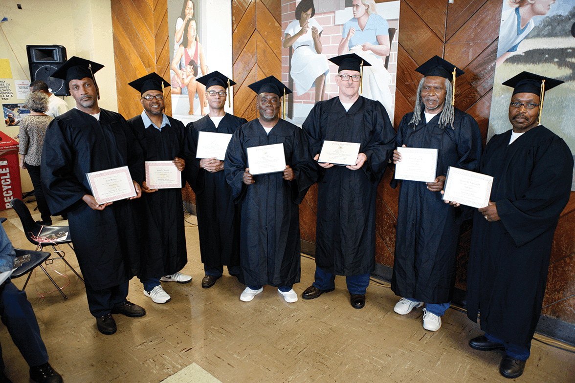 PUP graduates Darin Williams, Harry Hemphill, Jose Rivera, Nathan McKinney, Craig Johnson, Gerald Morgan and Claudius Johnson with their Associates of Arts degrees