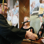 Craig Johnson receiving an Associates of Arts degree from PUP Academic Director Amy Jamgochian, Ph.D