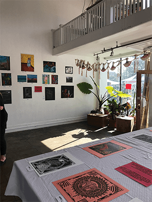 Paintings done by San Quentin artists displayed at the Cords Gallery