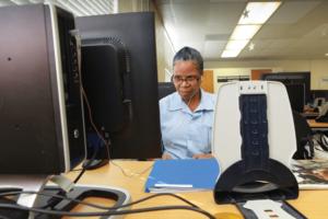 Female coder at work in CALPIA's coding program