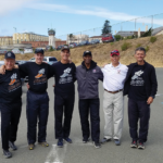 Eddie Hart (gray jacket) with 1000 Mile Club coaches Mark Stevens, Jim Maloney, Frank Ruona and Kevin Rumon.